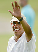 President Barack Obama waves to the crowd gathered at the 18th hole at the 18th hole at the Mid Pacific Country Club in Lanikai, Hawaii on January 1, 2014.<br /> Credit: Cory Lum / Pool via CNP