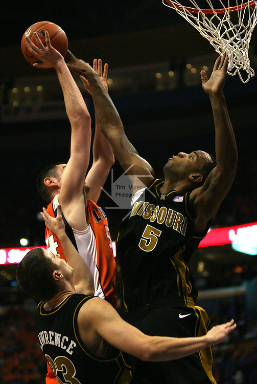 23 December 2008:   Mizzou's Leo Lyons (5, right) blocks a shot by Illini's Mike Tisdale (54, left) as Mizzou teammate Matt Lawrence (33, lower left) watches during first half of the game.  The University of Missouri and the University of Illinois competed in the annual Busch Braggin' Rights basketball game at the Scottrade Center in downtown St. Louis, Missouri on Tuesday December 23, 2008...