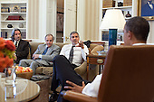 United States President Barack Obama meets with, from left: John Prendergast, activist and Enough Project co-founder; Ambassador Princeton N. Lyman, the U.S. Special Envoy for Sudan; and George Clooney, in the Oval Office, March 15, 2012. .Mandatory Credit: Pete Souza - White House via CNP