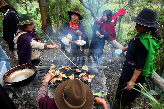 Mothers from the community of Salasaca gather to cook a lamb over a fire pit for the celebration of their children's graduation from Escuela Katitawa. The majority of the community is not educated, so when a child makes an achievement academically it is a celebrated event.