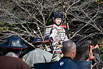 "Dressed in ornate period costume, a member of the Toyama-ryu ""yabusame"" horseback archery group reclaims his arrow during a yabusame ritual in Machida, western Tokyo, Japan on Nov. 28 2010. During the late Heian era (794 to 1185) and Kamakura era (1185-1333) such archery was the domain of high-ranked samurai and was used as a military training exercise to keep samurai prepared for war. .Photographer: Robert Gilhooly"
