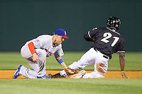 Ryan Goins (10) of the Buffalo Bisons tags out Jared Mitchell (21) of the Charlotte Knights as he tries to steal second base at BB&T Ballpark on May 9, 2014 in Charlotte, North Carolina.  The Knights defeated the Bisons 5-3.  (Brian Westerholt/Four Seam Images)