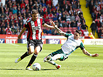 Chris Basham of Sheffield Utd tackled by \bduring the Championship League match at Bramall Lane Stadium, Sheffield. Picture date 19th August 2017. Picture credit should read: Simon Bellis/Sportimage