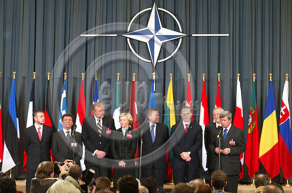 BRUSSELS - BELGIUM - 04 APRIL 2004--NATO celebration of the entry of the seven new member countries. From left Solomon Passy, Minister of Foreign Affairs, Bulgaria Antanas Valionis, Minister of Foreign Affairs, Lithuania Dimitrij Rupel, Minister of Foreign Affairs, Slovenia Kristiina Ojuland, Minister of Foreign Affairs, Estonia NATO Secretary General, Jaap de Hoop Scheffer Mircea Dan Geoana, Minister of Foreign Affairs, Romania Rihards Piks, Minister of Foreign Affairs, Latvia.Eduard Kukan, Minister of Foreign Affairs, Slovakia-- PHOTO: ERIK LUNTANG / EUP-IMAGES