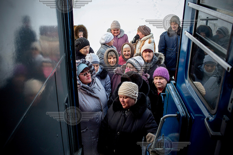 Villagers line up outside the door of the Matvey Mudrov train in -15C temperature, waiting for its doors to open at 9am. Most of the diagnostic services on the train are covered by public funding.<br /> <br /> The Matvei Mudrov train is a medical train operated by Russian Railways along the course of the Baikal Amur Magistral (Baikal-Amur Mainline, or BAM) railway line. Named after a famous 19th century Russian physician, the train employs around 15 doctors who make about 10 trips a year, each lasting two weeks. Along the way they deliver essential medical services to people living in remote villages along the 4,324 km long BAM railway. Though not equipped to carry out surgical procedures the train has heart monitors, ultrasound and x-ray machines to deliver diagnosis.