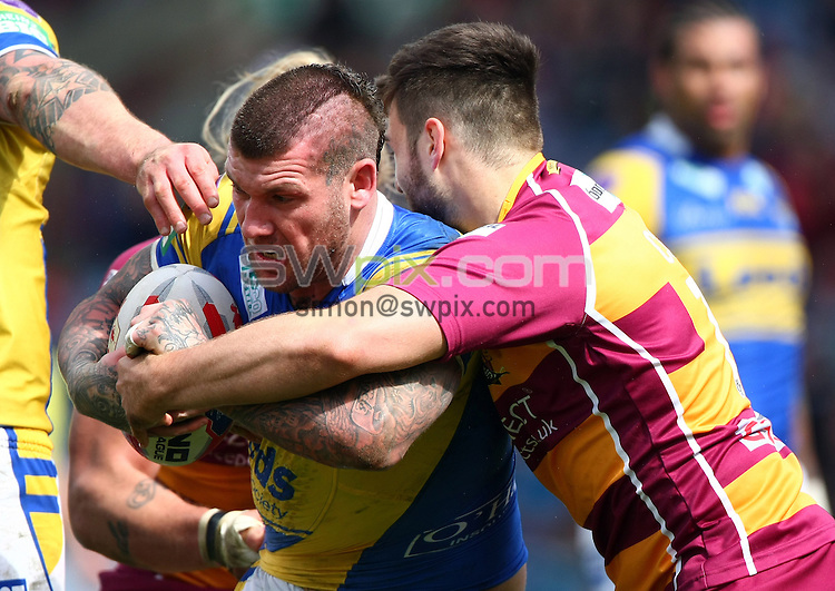 PICTURE BY VAUGHN RIDLEY/SWPIX.COM - Rugby League - Tetley's Challenge Cup, 5th Round - Huddersfield Giants v Leeds Rhinos - John Smiths Stadium, Huddersfield, England - 11/05/13 - Leeds Brett Delaney is tackled by Huddersfield's Jamie Cording.