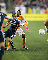 New England Revolution midfielder Scott Caldwell (6) blocks as Houston Dynamo midfielder Oscar Boniek Garcia (27) prepares to play a high ball.  The New England Revolution played to a 1-1 draw against the Houston Dynamo during a Major League Soccer (MLS) match at Gillette Stadium in Foxborough, MA on September 28, 2013.