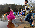 People run into the icy cold water, some in costume,  during the ninth annual Vernon Parks and Recreation Department Polar Plunge, Saturday, December 2, 2017, in Vernon. (Jim Michaud / Journal Inquirer)