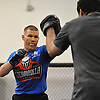 Matt Frevola, left, works with Ray Longo during a training session at Longo-Weidman MMA in Garden City on Tuesday, Jan. 9, 2018. Frevola, a 27-year-old mixed martial arts fighter and Huntington resident, will make his UFC debut this Sunday (Jan. 14) in St. Louis against opponent Marco Polo Reyes .