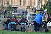 News photographers use laptops to file photos from the media area, College Green, Westminster, London, on the day Conservative MPs launched a challenge to Theresa May's leadership of the party.