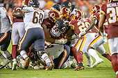 Chicago Bears running back David Montgomery (32) is gang tackled by a host of Washington Redskins players in the fourth quarter of the game at FedEx Field in Landover, Maryland on Monday, September 23, 2019.  The Bears won the game 31 - 15.<br /> Credit: Ron Sachs / CNP