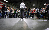 MItt Romney takes questions from the media following a town hall meeting to discuss jobs and the economy at Diamond V, an animal nutrition company in Cedar Rapids, Iowa on Friday, December 9, 2011. (Christopher Gannon/MCT)