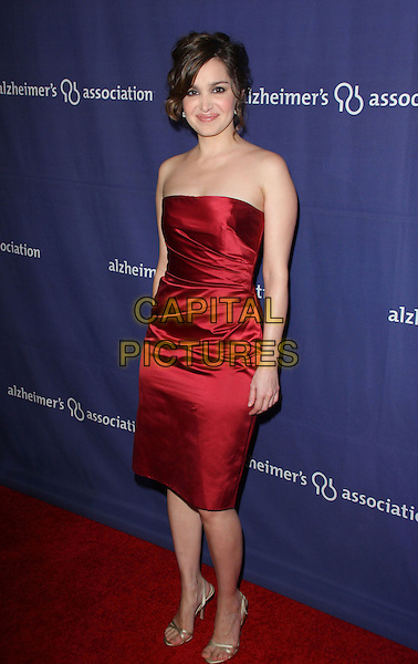 "GINA PHILIPS.The Alzheimer's Association's 17th Annual ""A Night At Sardi's"" held at the Beverly Hilton Hotel, Beverly Hills, California, USA..March 4th, 2009.full length red silk satin dress .CAP/ADM/KB.©Kevan Brooks/AdMedia/Capital Pictures."