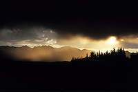 The sun sets amid stormy skies over Boreas Pass, Colorado.