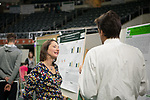 Andrea Gibson, Director of Research Communications discusses research with students at the Ohio University's Student Research and Creative Activity Expo. Photo by Ben Siegel
