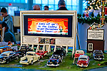 Dec. 26, 2012 - Garden City, New York, U.S. - The Long Island Garden Railway Society large-scale model train display is a festive winter holiday attraction in the vast 3-floor atrium of Cradle of Aviation museum, until shortly after New Years Day 2013. Classic car models are parked in front of Drive In Theater screen showing videos in this section of display. LIGRS shares the knowledge, fun, and camaraderie of large-scale railroading both indoors and in the garden, and is family oriented.