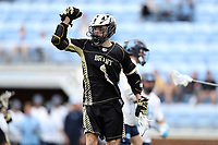 CHAPEL HILL, NC - MARCH 10: Logan McGovern #1 of Bryant University reacts after scoring a goal during a game between Bryant and North Carolina at Dorrance Field on March 10, 2020 in Chapel Hill, North Carolina.