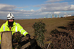 Anti nuclear protest at Hinkley Point north Somerset . Protesters have occupied a  farmhouse as A Group 4 private security  guard  watches over a protest at Hinkely point nuclear powerstation.EDF are clearing the land well  before  they have been given planning  permission for a  new power station at Hinkley C as part of  the UK  Government's new  nuclear plan
