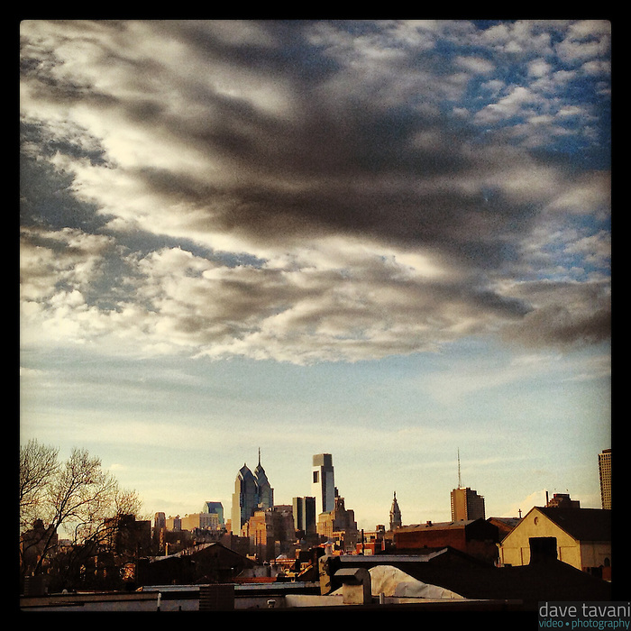 Clouds fly over the Philadelphia skyline, as seen from Queen Village, on the evening of March 13, 2013.