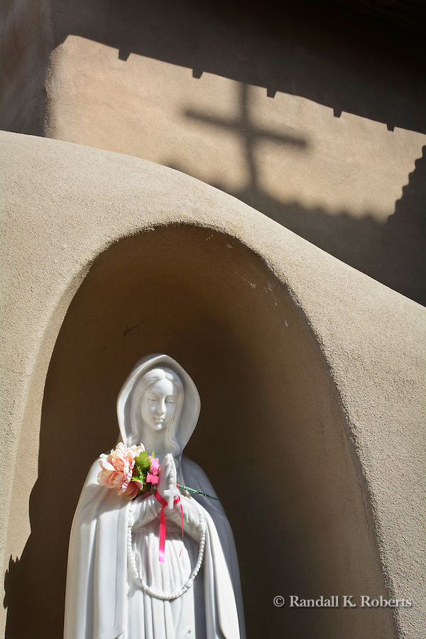 "Stature of Our Lady of Guadalupe at Santuario de Guadalupe church, Santa Fe, New Mexico The church is the oldest shrine to Our Lady of Guadalupe in the United States.   The city of ""holy faith"" contains many reminders of its Spanish Catholic roots."