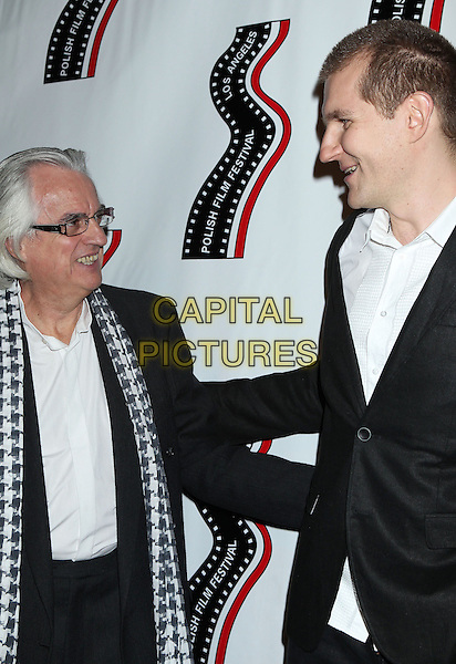 Vladek Juszkiewicz, Pawel Wysoczanski<br /> 13th annual Polish film festival at American Cinematheque's Egyptian Theatre, Hollywood, California, USA.<br /> 9th October 2012<br /> half length glasses scarf profile black suit jacket white shirt <br /> CAP/ADM/RE<br /> &copy;Russ Elliot/AdMedia/Capital Pictures