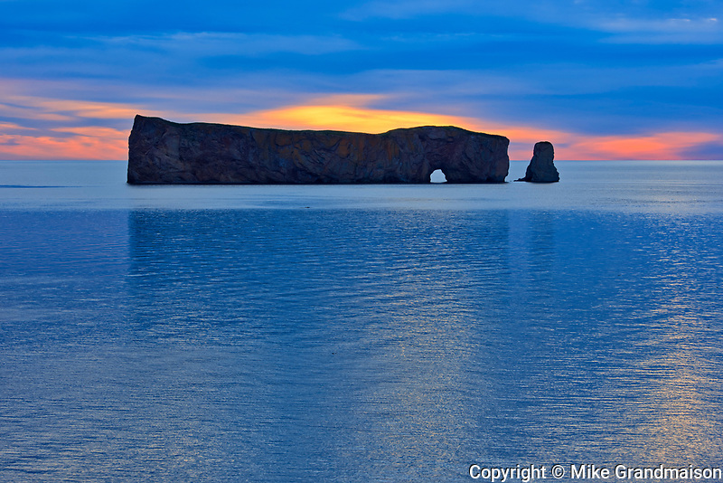 Le Rocher Percé or Percé Rock in the Atlantic Ocean at dusk<br />Percé<br />Quebec<br />Canada