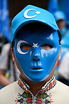 JUNE 29, 2019 - A protestor wears a mask and hat displaying the flag of East Turkestan, a symbol of Uyghur independence, at a demonstration against the Chinese government's treatment of the Uyghur ethnic group during the G20 Summit in Osaka, Japan. (Photo by Ben Weller/AFLO) (JAPAN) [UHU]