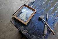 A water-damaged photograph of Barbara Earl's late husband and first wife lays on a damaged chest in her gutted home on Todd Preis Drive in the Nashville suburb of Bellevue on Saturday, May 8, 2010.