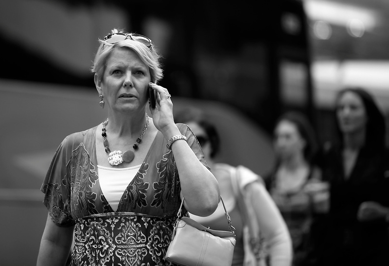 New Yorkers make calls on their mobile phones while walking in Manhattan