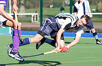 Dan Fox in acrobatic action for Hampstead during the England Hockey League Mens Semi-Final Cup game between Hampstead & Westminster and Sevenoaks at the Paddington Recreation Ground, Maida Vale on Sun March 21, 2010