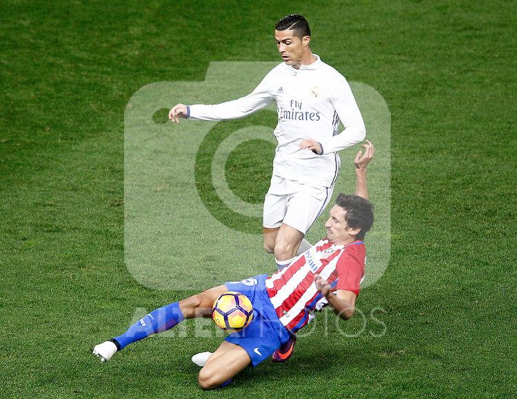 Atletico de Madrid's Stefan Savic (r) and Real Madrid's Cristiano Ronaldo during La Liga match. November 19,2016. (ALTERPHOTOS/Acero)