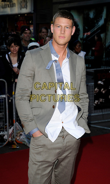 TOM HOPPER.UK Premiere of 'Tormented' at the Empire, Leicester Square, London, England. .May 19th 2009 .half length grey gray suit white shirt untucked blue collar hands in pockets .CAP/CAN.©Can Nguyen/Capital Pictures.