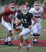 NWA Democrat-Gazette/ANDY SHUPE<br /> Arkansas quarterback Daulton Hyatt rolls out to pass Thursday, Aug. 9, 2018, during practice at the university's practice facility in Fayetteville. Visit nwadg.com/photos to see more photos from practice.
