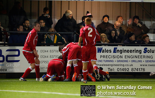 Llandudno 2 Denbigh Town 2, 20/03/2015. Maesdu Park, Huws Gray Alliance Football League. Denbigh Town players celebrate Stuart Vernon's equaliser. Needing a win to guarantee promotion to the top division of Welsh football for the first time, Llandudno took the lead twice, but were held to a draw against Denbigh Town.<br /> Llandudno installed an artificial 3G pitch in 2014. The pitch is available for hire, and enables to club to have an active community programme, and teams in every age range, all playing at Maesdu Park. Photo by Paul Thompson.