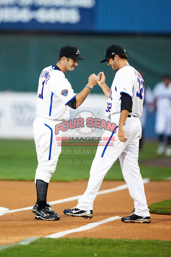 Aberdeen Ironbirds catcher Sam Kimmel #1 and Lucas Herbst #32 during introductions before the NY-Penn League All-Star Game at Eastwood Field on August 14, 2012 in Niles, Ohio.  National League defeated the American League 8-1.  (Mike Janes/Four Seam Images)
