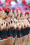 University of Louisville cheerleaders hold their hands over their hearts for the National Anthem. The No. 8-rank Louisville Cardinals (2-0) defeated the Middle Tennessee State Raiders 58-42. The high-scoring affair lasted 3 hours, 54 minutes in front of 40,882 in Louisville.