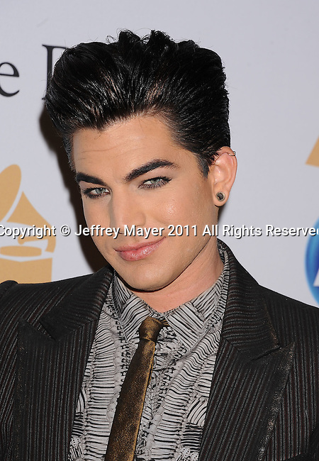BEVERLY HILLS, CA - FEBRUARY 12: Adam Lambert arrives at the 2011 Pre-GRAMMY Gala and Salute To Industry Icons Honoring David Geffen at The Beverly Hilton Hotel on February 12, 2011 in Beverly Hills, California.