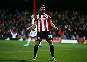 2nd December 2017, Griffen Park, Brentford, London; EFL Championship football, Brentford versus Fulham; Yoann Barbet of Brentford celebrates towards the fans after Romaine Sawyers of Brentford scored his sides 2nd goal in the 49th minute to make it 2-1
