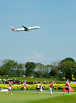 SINGAPORE - MARCH 08:  An airplane flight over the par four 18th hole during the final round of HSBC Women's Champions at the Tanah Merah Country Club on March 8, 2009 in Singapore.  Photo by Victor Fraile / The Power of Sport Images