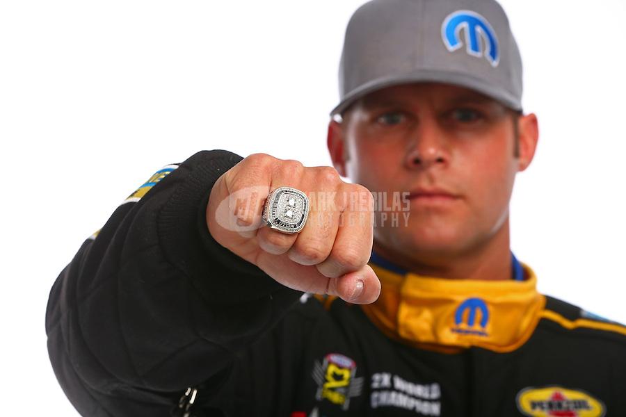 Feb 10, 2016; Pomona, CA, USA; NHRA funny car driver Matt Hagan poses for a portrait with his championship ring during media day at Auto Club Raceway at Pomona. Mandatory Credit: Mark J. Rebilas-USA TODAY Sports