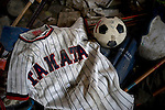 A soccer ball and baseball shirt lies among the debris strewn across the floor of the sports center where Hideharu Sasaki was almost drowned following the March 11 tsunami in Rikuzebtakata, Iwate Prefecture, Japan on 09 March 2012. Around 100 people died in the sports center, while 4 people survived...Photographer: Robert Gilhooly.