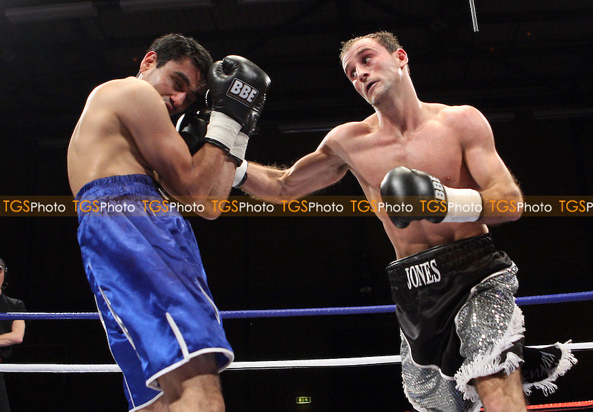 Ben Jones (Crawley, black silver shorts) defeats Sid Razak (blue shorts, Birmingham) in a Super-Featherweight Boxing contest at Goresbrook Leisure Centre, Dagenham, Essex promoted by Barry Hearn / Matchroom Sport -  05/12/08 - MANDATORY CREDIT: Gavin Ellis/TGSPHOTO - Self billing applies where appropriate - Tel: 0845 094 6026