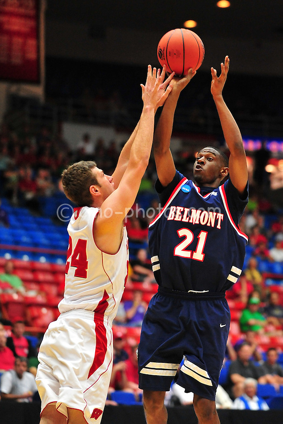 Mar 17, 2011; Tucson, AZ, USA; Belmont Bruins guard Ian Clark (21) shoots over Wisconsin Badgers guard Tim Jarmusz (24) in the first half of a game in the second round of the 2011 NCAA men's basketball tournament at the McKale Center.