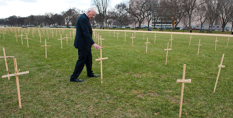 UNITED STATES - Dec 5: Senator Patrick Leahy, D-VT., walks among the crosses that are set up outside the tent of the Fast for Families group protesting on the National Mall in Washington, D.C. Leaders and immigrant members of the community will fast every day starting on November 12th, abstaining from all food—except water. The protesters are hoping persuade members of Congress to pass immigration reform with a path to citizenship. (Photo By Douglas Graham/CQ Roll Call)