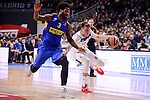 Real Madrid's Luka Doncic and Maccabi Fox's Victor Rudd during Turkish Airlines Euroleague match between Real Madrid and Maccabi at Wizink Center in Madrid, Spain. January 13, 2017. (ALTERPHOTOS/BorjaB.Hojas)