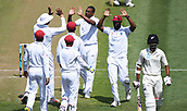 9th December 2017, Seddon Park, Hamilton, New Zealand; International Test Cricket, 2nd Test, Day 1, New Zealand versus West Indies;  Shannon Gabriel and team mates celebrate the wicket of Raval
