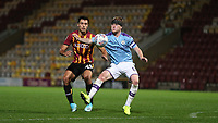 DannY Devine of Bradford City and Tommy Doyle of Man City during the The Leasing.com Trophy match between Bradford City and Manchester City U21 at the Utilita Energy Stadium, Bradford, England on 24 September 2019. Photo by Thomas Gadd.