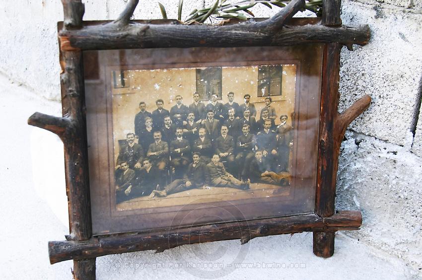 An old class photograph of the grandfather of Fano Banicevic sitting in the front row.. Toreta Vinarija Winery in Smokvica village on Korcula island. Vinarija Toreta Winery, Smokvica town. Peljesac peninsula. Dalmatian Coast, Croatia, Europe.