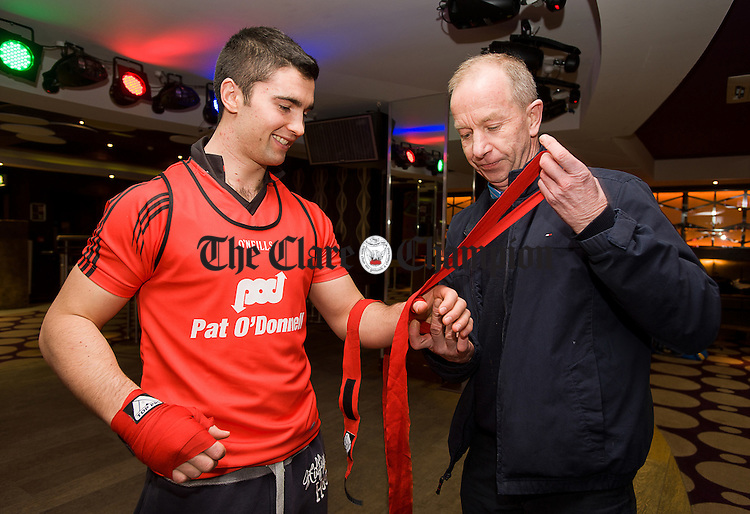 Caimin Morey gets his  fists wrapped by coach Tony Hurson at the Clare Hurlers Fight Night in the Queens hotel, aid of The Clare Senior Hurlers Fund. Photograph by John Kelly.