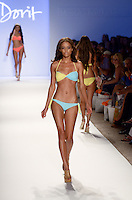 Model walks runway at Dorit Swimwear Show during Mercedes Benz IMG Fashion Swim Week 2013 at The Raleigh Hotel, Miami Beach, FL on July 23, 2012